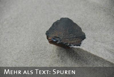 Stein im Sand